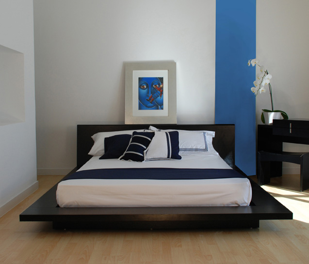 Modern-minimalistic-elegant-bedroom-with-edgy-wood-frame-bed-and-a-hangging-above-it-picture
